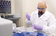 A technician conducting a test at Grifols' CLIA lab